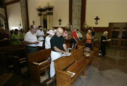 Foreign residents attend a mass at the Saint Andrew Apostle church in Ajijic June 10, 2012. REUTERS/Alejandro Acosta