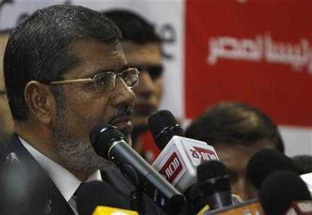 Muslim Brotherhood's presidential candidate Mohamed Morsy talks during a news conference in Cairo June 18, 2012. REUTERS/Amr Abdallah Dalsh