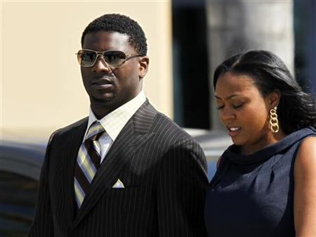 Former San Diego Charger running back LaDainian Tomlinson and his wife LaTorsha arrive for the funeral services of former teammate and NFL linebacker Junior Seau at the Calvary Chapel in Oceanside, California May 11, 2012. REUTERS/Mike Blake