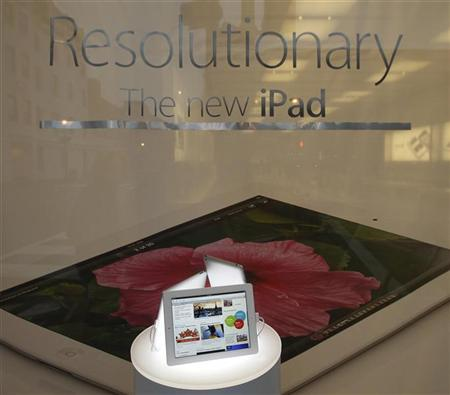 An Apple iPad is pictured in a display window at the Apple Store in Washington, March 16, 2012. REUTERS/Gary Cameron
