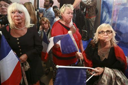 Supporters of Marine Le Pen, France's National Front leader and candidate for the legislative elections, react after their candidate lost in the run-off election in Henin-Beaumont June 17, 2012. REUTERS/Jean-Yves Bonvarlet