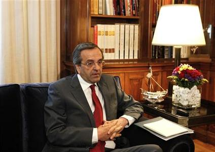 Leader of the conservative New Democracy party Antonis Samaras looks on during a meeting with President Karolos Papoulias before he receives a mandate to form a government in Athens June 18, 2012. REUTERS/Yorgos Karahalis