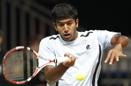 India's Rohan Bopanna hits a return to Russia's Mikhail Youzhny during their Davis Cup World Group first round tennis match in Moscow March 5, 2010. REUTERS/Grigory Dukor