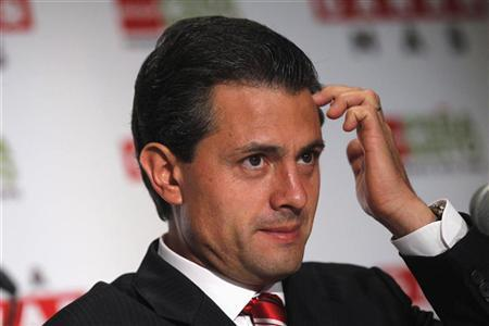 Enrique Pena Nieto, candidate of the opposition Institutional Revolutionary Party (PRI), gestures during a news conference in Mexico city June 14, 2012. REUTERS/Edgard Garrido