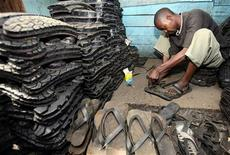 A man makes footwear from tyres at the open-air Ngara market near the capital Nairobi May 2, 2007. REUTERS/Antony Njuguna
