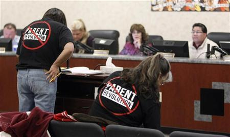 Chrissy Guzman (L) speaks to the Adelanto School District board meeting regarding the parent trigger law, in Adelanto, California March 6, 2012. REUTERS/Alex Gallardo