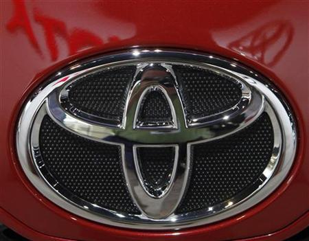 The Toyota emblem on a Camry is displayed during the first media preview day at the 2011 Chicago Auto Show in Chicago, Illinois February 9, 2011. REUTERS/Frank Polich