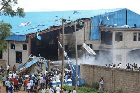 Onlookers gather near the bomb-damaged Shalom Church in the northern Nigerian city of Kaduna June 17, 2012. REUTERS/Stringer