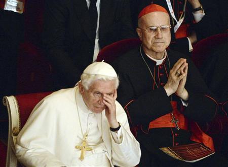Vatican State Secretary Cardinal Tarcisio Bertone observes Pope Benedict XVI at La Scala theater during a concert in Milan, June 1, 2012. REUTERS/Daniel Dal Zennaro/Pool