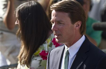 Former U.S. Senator John Edwards exits the courthouse with daughter, Cate Edwards (L) after the jury reached a verdict at the federal courthouse in Greensboro, North Carolina May 31, 2012. REUTERS/John Adkisson