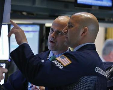 Traders work on the floor of the New York Stock Exchange June 18, 2012. REUTERS/Brendan McDermid