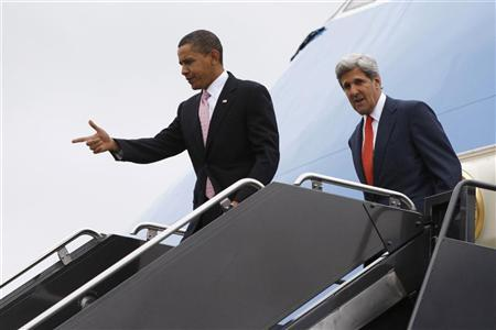 U.S. President Barack Obama (L) and U.S. Senator John Kerry (D-MA) step off Air Force One in Boston, October 23, 2009. Obama travelled to Boston to visit the Massachusetts Institute of Technology (MIT) in Cambridge. REUTERS/Jason Reed