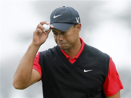 Tiger Woods of the U.S. reacts after his bogey on the first hole during the final round of the 2012 U.S. Open golf tournament on the Lake Course at the Olympic Club in San Francisco, California June 17, 2012. REUTERS/Robert Galbraith