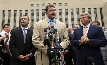 Former baseball star Roger Clemens speaks outside Federal District Court in Washington June 18, 2012. REUTERS/Kevin Lamarque