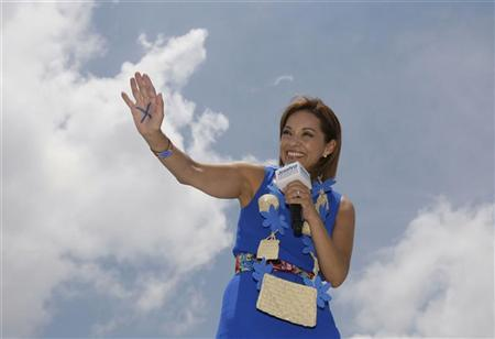 Josefina Vazquez Mota, presidential candidate for the ruling National Action Party (PAN), shows an ''X'' on the palm of her hand to remind supporters how to cast their vote during a rally in Atlixco, in the Mexican state of Puebla June 18, 2012. REUTERS/Imelda Medina