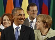 Премьер-министр Австралии Джулия Гиллард, президент США Барак Обама, премьер Испании Мариано Рахой и канцлер Германии Ангела Меркель (слева направо) на саммите G20 в Лос-Кабосе 18 июня 2012 года. Мировые лидеры в понедельник потребовали, чтобы Европа приняла смелые меры для преодоления кризиса, так как победа проевропейских партий на выборах в Греции не смогла успокоить рынки и смягчить страхи о перспективах мировой экономики. REUTERS/Jason Reed