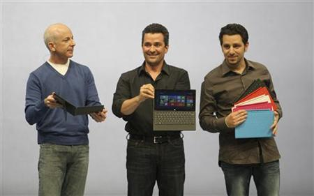President of the Windows and Windows Live Division Steven Sinofsky (L), Corporate Vice President of Windows Planning, Hardware & PC Ecosystem Michael Angiulo and GM of Microsoft Surface Panos Panay (R) hold the new Surface as it is unveiled in Los Angeles, California, June 18, 2012. REUTERS/David McNew