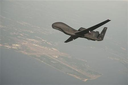 Undated file photo courtesy of the U.S. Navy shows a RQ-4 Global Hawk unmanned aerial vehicle conducting tests over Naval Air Station Patuxent River, Maryland. REUTERS/U.S. Navy/Erik Hildebrandt/Northrop Grumman/Handout
