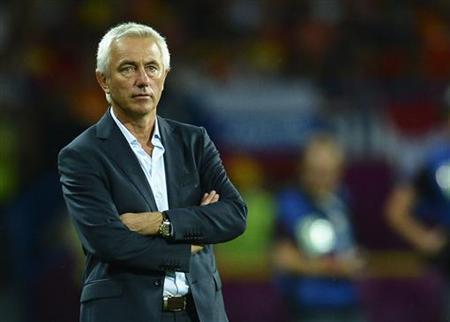 Netherlands' coach Bert van Marwijk watches during their Group B Euro 2012 soccer match against Portugal at the Metalist stadium in Kharkiv, June 17, 2012. REUTERS/Felix Ordonez