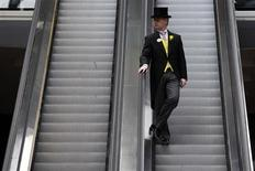 A racegoer rides an escalator down from the Royal Enclosure on the first day of racing at Royal Ascot in southern England June June 19, 2012 REUTERS/Stefan Wermuth