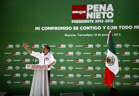 Enrique Pena Nieto, presidential front-runner of the opposition Institutional Revolutionary Party (PRI), delivers a speech during a rally in Reynosa, in the Mexican state of Tamaulipas June 18, 2012. REUTERS/Stringer