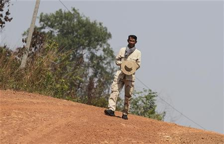 Chut Wutty, Director of the Natural Resource Protection Group, walks at Botum Sakor National Park in Koh Kong province, in this February 20, 2012 file photo. Chut Wutty, a prominent Cambodian anti-logging activist who helped expose a secretive state sell-off of national parks was fatally shot on April 25, 2012 in a remote southwestern province, said police. Picture taken February 20, 2012. REUTERS/Samrang Pring/Files