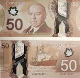 Images of the front and the back of the new Canadian 50 dollar bill, made of polymer, are seen on display before a news conference in Quebec City, March 26, 2012. REUTERS/Mathieu Belanger