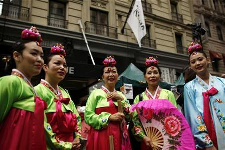 Revellers attend a Korean parade organized by the Korean American Association to celebrate its 30th anniversary, at Midtown Manhattan in New York October 1, 2011. REUTERS/Eduardo Munoz