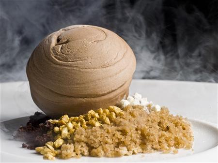 Dessert Chocolate Coulant Nitro by Spanish chef Paco Roncero is seen in this undated handout photo. Roncero, the two Michelin-starred chef who gained recognition as Chef Ferran Adria's most famous disciple, on June 15, 2012 opened VIEW 62, a revolving restaurant at the 62nd floor of Hopewell Centre in Hong Kong. Roncero spoke to Reuters about his passion and taking risks in creating new dishes, and convincing his diners to discover ''nouvelle cuisine'' - his name for his own version of European cuisine. REUTERS/VIEW 62/Handout