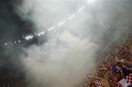 Croatia soccer fans let off flares during their teams Group C Euro 2012 soccer match against Spain at the PGE Arena in Gdansk, June 18, 2012. REUTERS/Kai Pfaffenbach