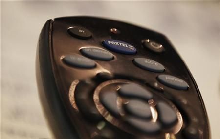 A Foxtel remote control is seen in a store in central Sydney May 26, 2011. REUTERS/Daniel Munoz