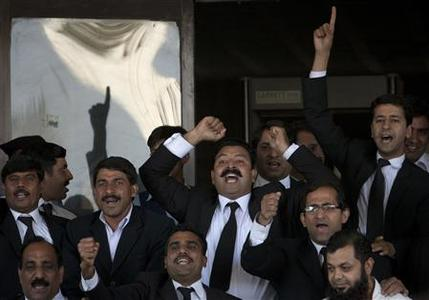 Lawyers chant slogans in favour of a decision by the Supreme Court of Pakistan outside the court building in Islamabad June 19, 2012. Pakistan's increasingly assertive Supreme Court on Tuesday declared Prime Minister Yusuf Raza Gilani ineligible for office, plunging the country into fresh political turmoil during a crisis in relations with the United States. In April, it found Gilani guilty of contempt of court for refusing to reopen corruption cases against the president. REUTERS/Faisal Mahmood
