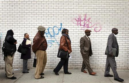 Jobseekers stand in line to attend the Dr. Martin Luther King Jr. career fair held by the New York State department of Labor in New York April 12, 2012. REUTERS/Lucas Jackson