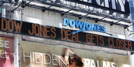 The Dow Jones news ticker is seen above Times Square in New York, July 31, 2007. REUTERS/Shannon Stapleton