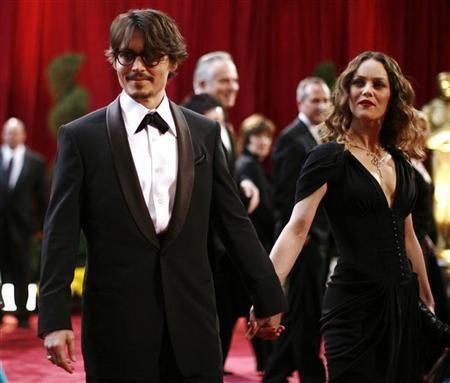 Johnny Depp, dressed in Giorgio Armani tuxedo and Anto Beverly Hills shirt, best actor Oscar nominee for ''Sweeney Todd The Demon Barber of Fleet Street,'' arrives with his girlfriend Vanessa Paradis, dressed in Chanel and wearing Chanel Fine Jewelry, at the 80th annual Academy Awards in Hollywood February 24, 2008. REUTERS/Carlos Barria