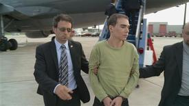 Luka Rocco Magnotta, 29, accused of killing a Chinese student, Jun Lin, and sending his feet and hands in the mail to the offices of two Canadian political parties and two Vancouver schools, is escorted off a plane from Germany by Montreal police in Montreal June 18, 2012 in this handout photo. Magnotta, who is accused of first-degree murder, was arrested in a cyber cafe in Berlin two weeks ago. REUTERS/SPVM/Handout.