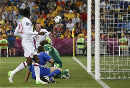 England's Wayne Rooney (2nd L) scores a goal against Ukraine during their Group D Euro 2012 soccer match at Donbass Arena in Donetsk June 19, 2012. REUTERS/Michael Buholzer