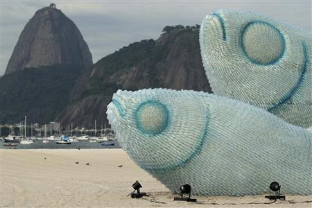 Giant fish made with plastic bottles are exhibited at Botafogo beach, in Rio de Janeiro June 19, 2012. REUTERS / Ueslei Marcelino