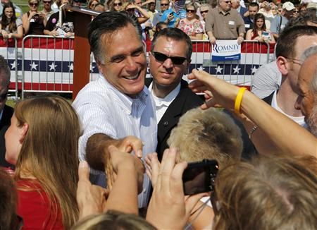 U.S. Republican Presidential candidate Mitt Romney shakes hands after speaking at a campaign event at the Bavarian Inn Lodge in Frankenmuth, Michigan, June 19, 2012. REUTERS/Larry Downing