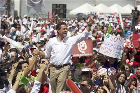 Enrique Pena Nieto, presidential front-runner of the opposition Institutional Revolutionary Party (PRI), is greeted by supporters as he arrives to a rally in Ciudad Obregon, in the Mexican state of Sonora June 19, 2012. REUTERS/Juan Carlos Morales