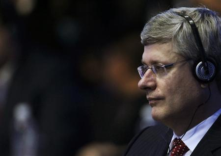 Canada's Prime Minister Stephen Harper waits for the beginning of the first session of the G20 Summit in Los Cabos June 18, 2012. G20 leaders kicked off two days of meetings in the Pacific resort of Los Cabos on Monday. REUTERS/Edgard Garrido