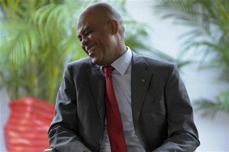 Haiti's President Michel Joseph Martelly reacts to a comment during the inauguration ceremony of newly appointed Prime Minister Laurent Lamothe at the National Palace in Port-au-Prince May 16, 2012. REUTERS/Swoan Parker