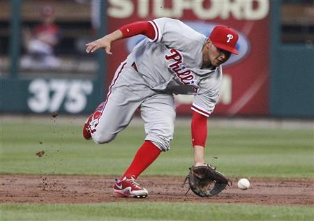 Philadelphia Phillies second baseman Freddy Galvis fields a ball hit by St. Louis Cardinals starting pitcher Kyle Lohse during the second inning of their MLB baseball game in St. Louis, Missouri, May 25, 2012. REUTERS/Sarah Conard