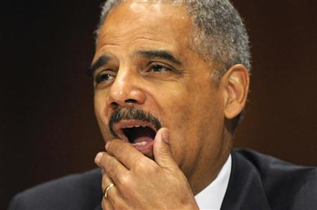 U.S. Attorney General Eric Holder rubs his face as he testifies before the Senate Judiciary Committee on Capitol Hill in Washington, June 12, 2012. REUTERS/Jonathan Ernst