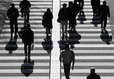 People walk on a crosswalk in Tokyo in this January 11, 2011 file photo. REUTERS/Yuriko Nakao/Files