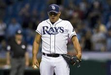 Tampa Bay Rays reliever Joel Peralta takes a deep breath before striking out Seattle Mariners' Chone Figgins to end the game and save a 5-4 win during their MLB American League game in St. Petersburg, Florida, May 2, 2012. REUTERS/Steve Nesius