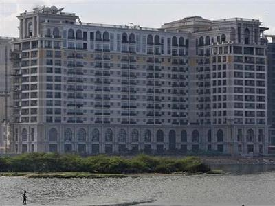 A man fishes in front of the under-construction India's Hotel Leela, facing the backwaters of Bay of Bengal, near the coastal area of the southern Indian city of Chennai June 14, 2012. Lenders to India's Hotel Leela, a 5-star chain that is more than two months behind in payments on $700 million of debt, are likely to bite the bullet and amend the loan terms rather than declare it in default, say bankers involved in the talks. Picture taken June 14, 2012. To match Analysis INDIA-BANKS/LOANS REUTERS/Babu
