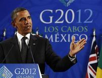 """Президент США Барак Обама выступает на пресс-конференции саммита """"Большой двадцатки"""" в Лос-Кабос, Мексика, 19 июня 2012 года. Европа заручилась поддержкой мировых лидеров во вторник для амбициозного, но трудоемкого """"капитального ремонта"""" еврозоны, несмотря на возросшее давление на финансовых рынках для ускорения решения проблем долгового кризиса, угрожающего мировой экономике. REUTERS/Jason Reed"""
