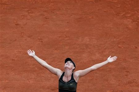 Maria Sharapova of Russia reacts after winning her women's singles final match against Sara Errani of Italy at the French Open tennis tournament at the Roland Garros stadium in Paris June 9, 2012. REUTERS/Nir Elias