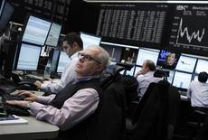 Traders concentrate on their screens at the Frankfurt stock exchange February 2, 2012. REUTERS/Alex Domanski